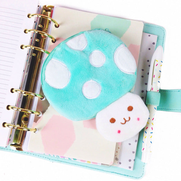 Mushroom shaped coin pouch in mint color on mint kikki k planner