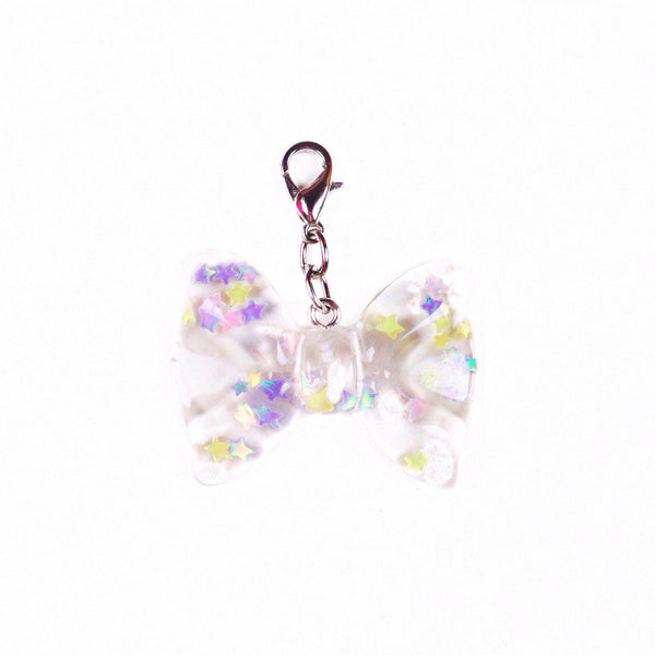 Clear resin bow charm with iridescent stars inside perfect for travelers notebooks