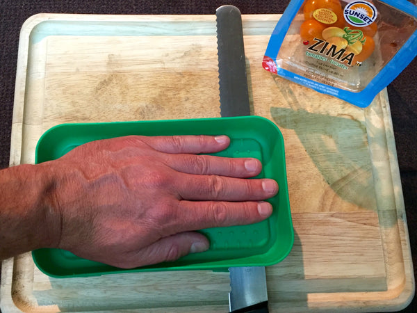 2. place the top tray on and use your hand to guide the knife