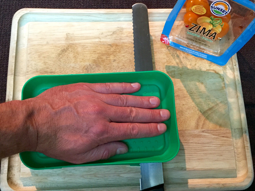 Step 2- Place the lid on top, use your hand as guide and slice parallel to the counter