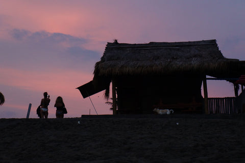 pink old mans beach canggu sunset with surf shacks