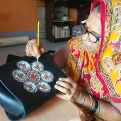Hand-painted madhubani art on genuine leather handbags by Shant Devi