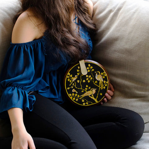 Seeds of Love, yellow and black round wood clutch