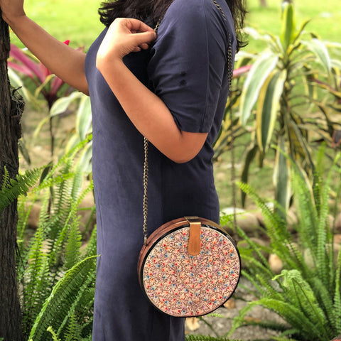 Be Like Lotus, round wood clutch