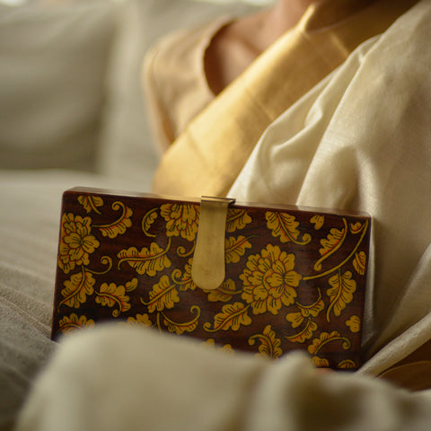 Seeds of Love, gold and black round wood clutch
