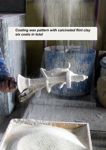 Coating wax pattern with calcinated flint clay - bronze sculptures - bronze casting using the lost wax casting process