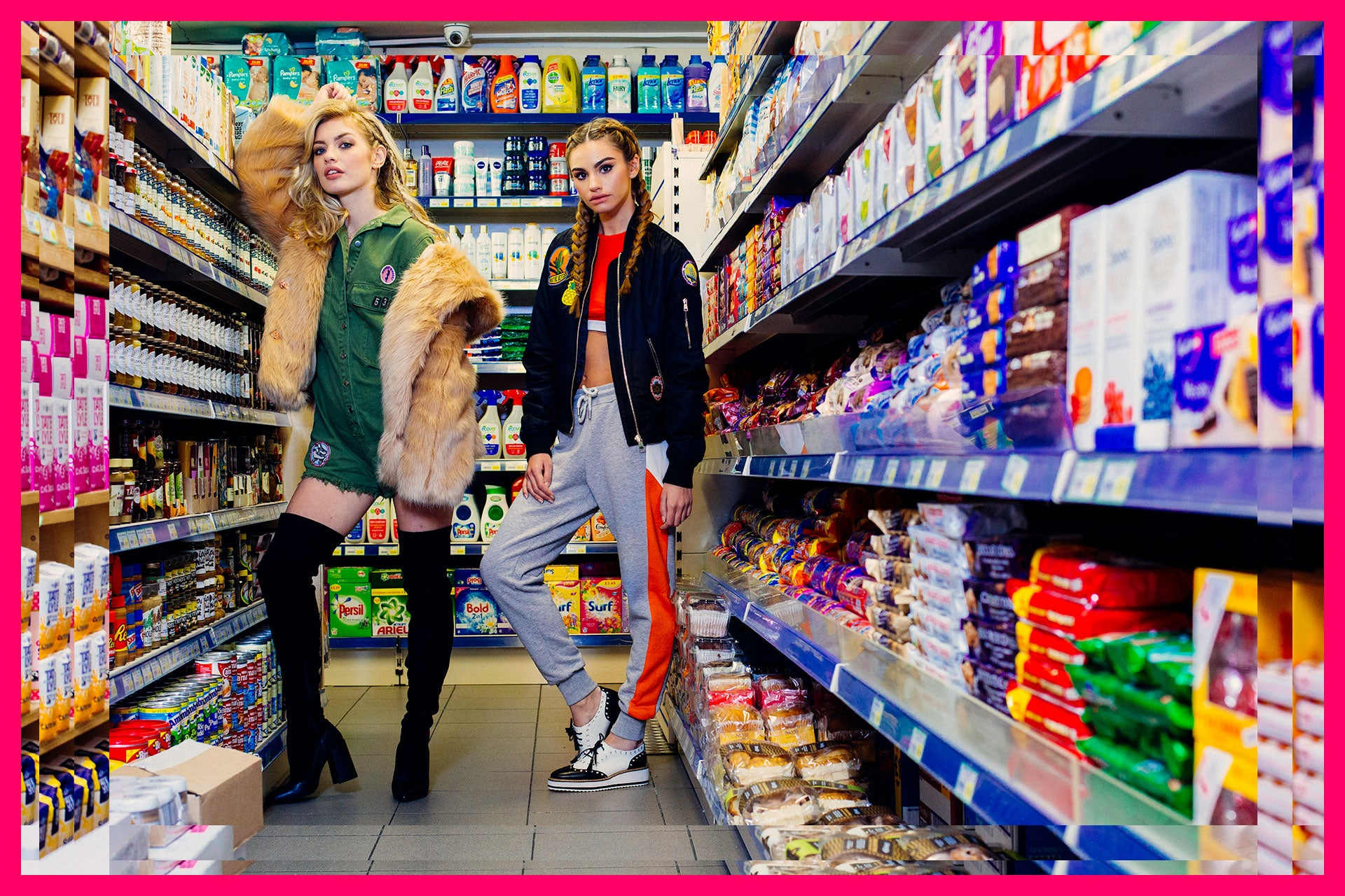 two young girls standing in shop aisle