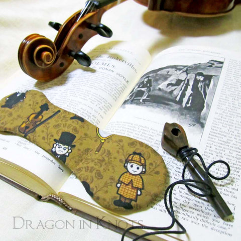 Sherlock Holmes book weight on vintage book with viola and pipe
