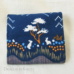 Dragon in Knots wallet prototype 2 closed - bunnies on navy blue