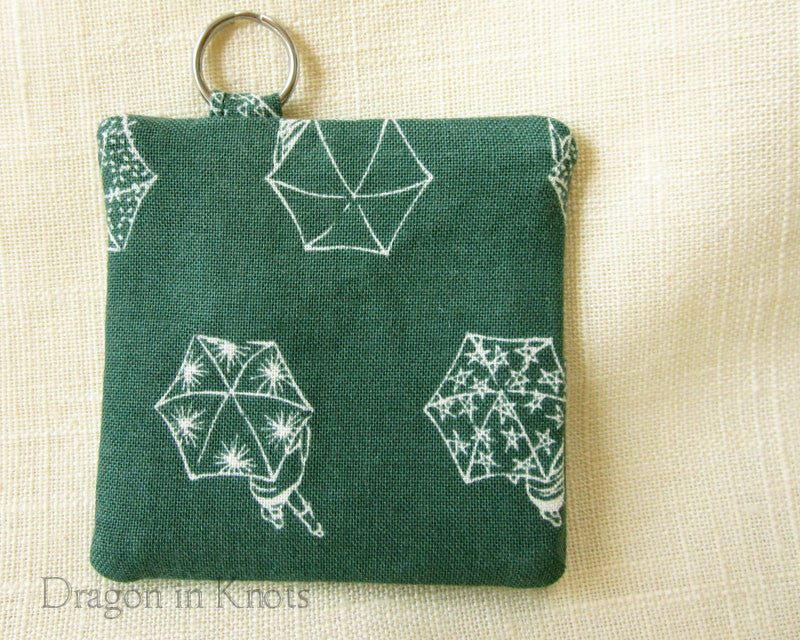 umbrella themed green earbud pouch
