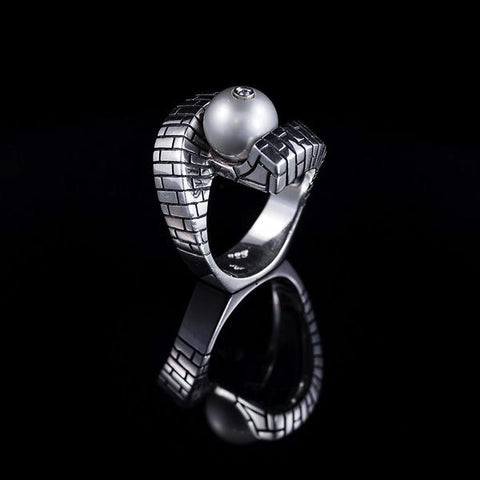 A hinged sterling silver bamboo textured bangle featuring two 12mm Tahitian pearls