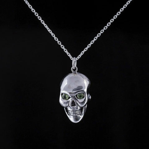 Large skull pendant with peridot eyes