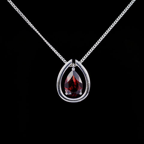 Garnet silver drop pendant with a detachable sterling silver collar