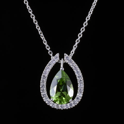 Peridot drop pendant with detachable white sapphire pave collar