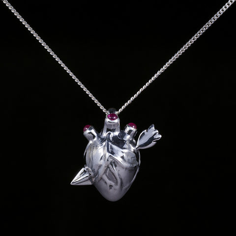 Love hurts,sterling silver heart and arrow pendant