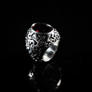 Empire mens signet ring with a garnet center stone