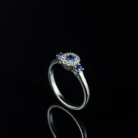 Blue and white sapphire halo engagement ring