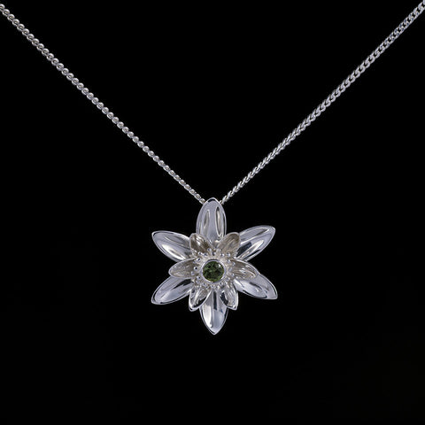 Gift of enlightenment lotus flower pendant with green sapphire