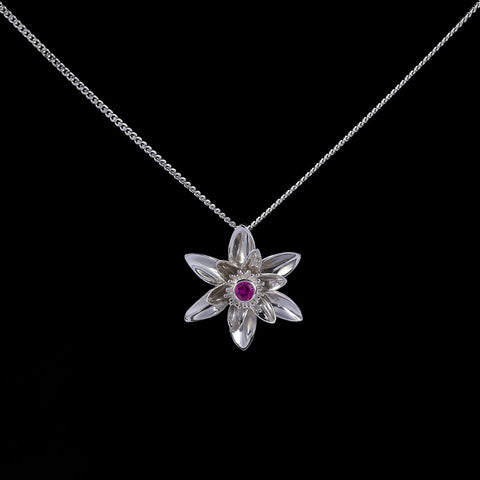 Gift of enlightenment lotus flower pendant with pink sapphire
