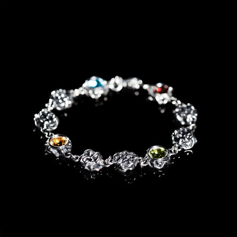 Sterling silver bracelet with bezel set multicolour gemstones