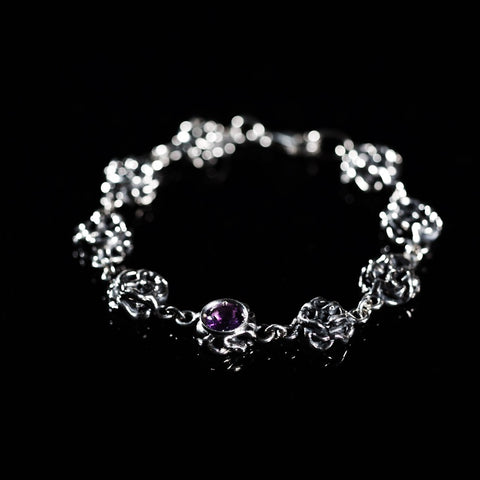Sterling silver bracelet with a bezel set gemstone