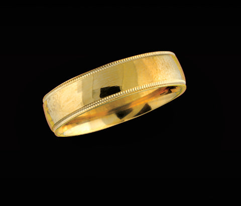Men's 6mm yellow gold wedding band with beaded edge