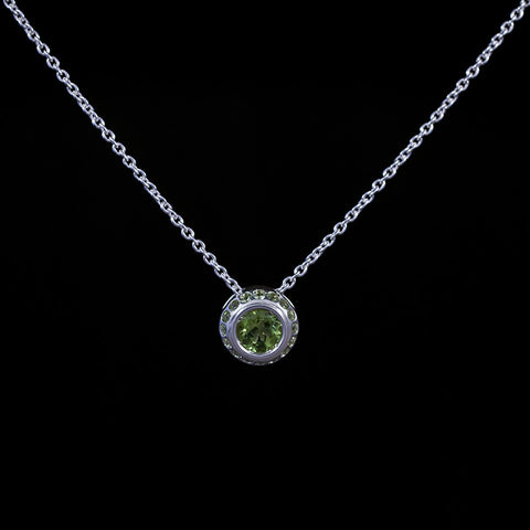 Peridot pendant with matching pave