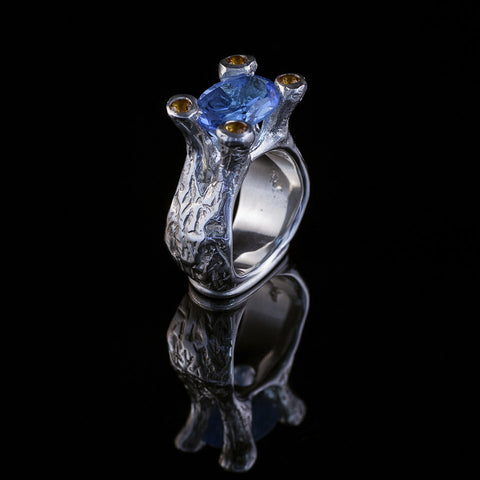 Amphora Ring with blue topaz center stone and citrine set prongs
