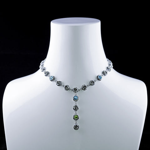 Blossoms l is a multi-colored gemstone necklace in bezel setting with drop-chain