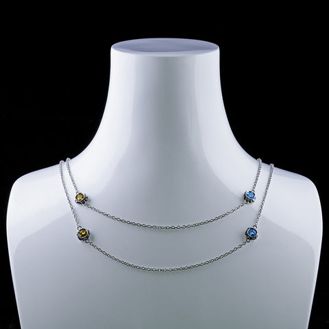 Blossoms ll is a multi-colored gemstone necklace in bezel setting strung on silver chain