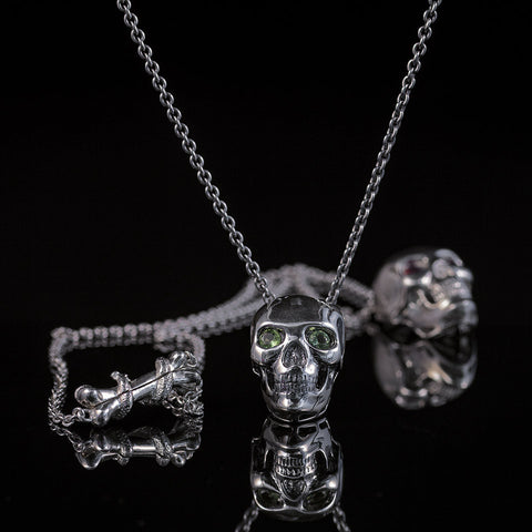 Skull Pendant with Peritot eyes and  Bone & Snake Clasp
