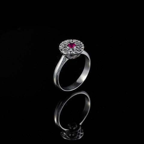 Icons l is a byzantine inspired ring with a ruby centre stone