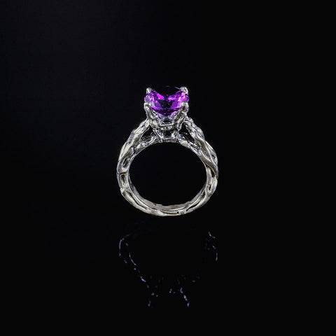 Amethyst claw set ring in sterling silver
