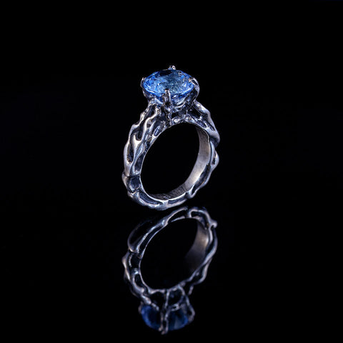 Blue topaz claw set ring in sterling silver