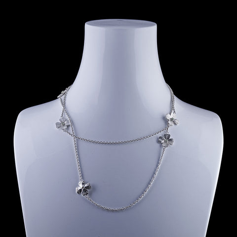 Blossoms lll A peridot flower necklace in sterling silver with a hidden white gold clasp