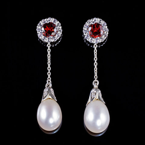 Garnet studs with white sapphire halo and dangling pearls