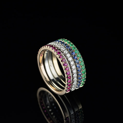 Diamond,emerald,sapphires and ruby stacking half eternity bands in 14 carat gold and palladium