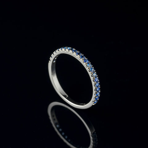 5mm Blue sapphire earrings in 14 carat white gold setting with a white sapphire halo and pearls