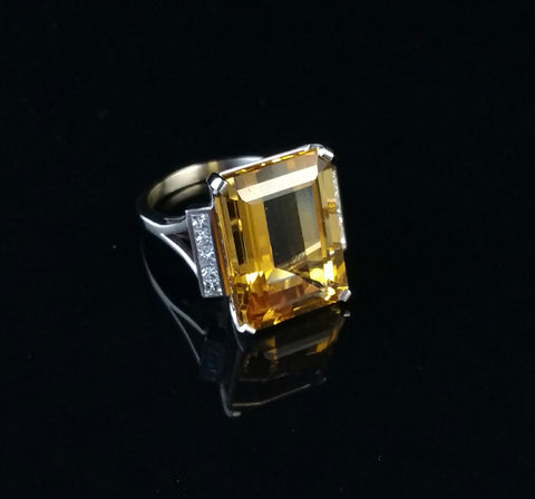 Yellow sapphire engagement ring with white diamond halo