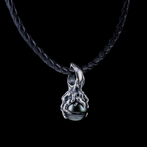 The bell pendant is a Tahitian pearl with a textured bail on a leather cord.
