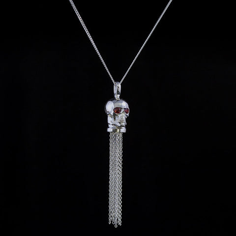 Skull pendant with dangling tassel sterling silver and garnets