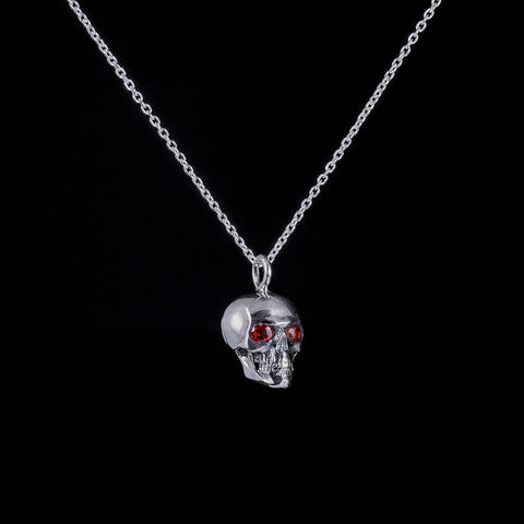 Round skull pendant with garnet eyes