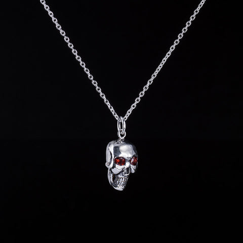 Medium skull pendant with garnet eyes