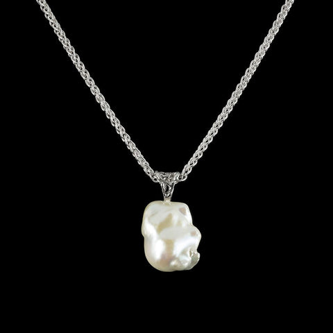 The glow a fresh water pearl necklace with 14 carat gold sun motif magnetic clasp.