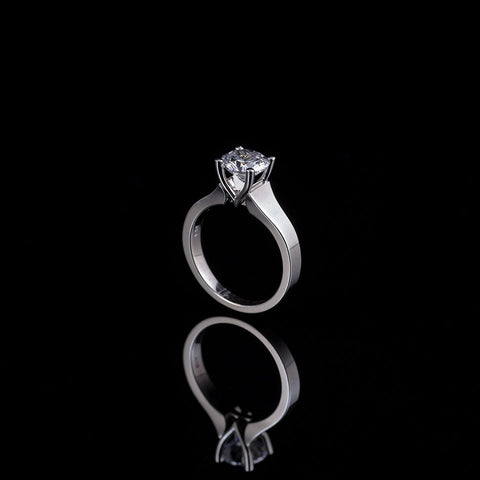 1 carat diamond solitaire set in white gold prongs with a white gold shank