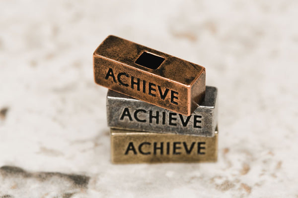 Achieve Brick 212 west personalized necklaces and word blocks