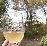 Surviving Motherhood Stemless Wine Glass