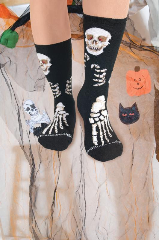 Wheel House Designs Skeleton Sock on a Model shows how fun it is to wear this pair of socks