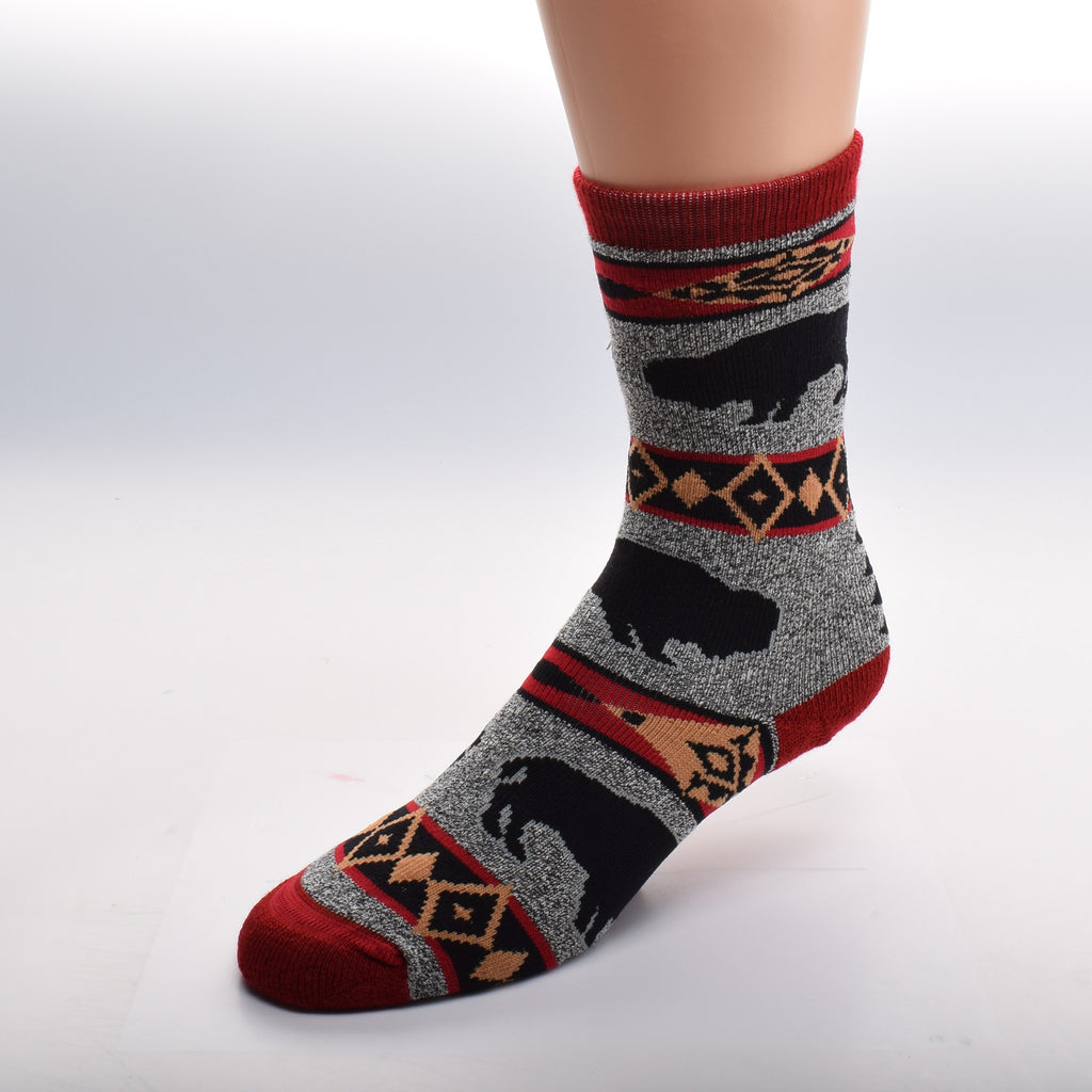 For Bare Feet Buffalo Blanket Motif Sock comes in Sizes Medium and Large. The background is a Heather Grey. The Cuffs, Heels and Toes are Maroon. The breaks are designed in American Tribal Motif of Red, Black and Gold. The Buffalo are Black Silhouettes.