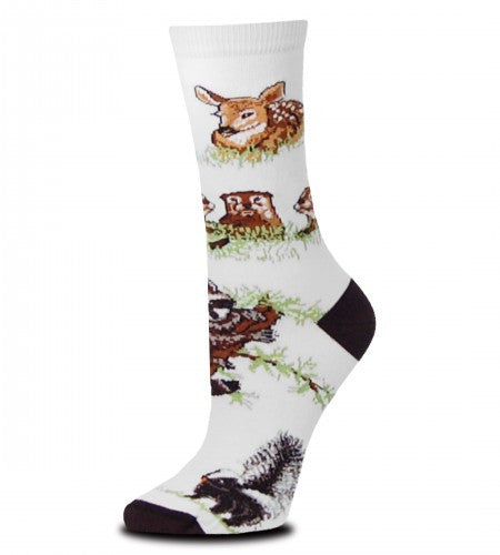 Woodland Creatures has a White background and Black Toes and Heels. Around the Sock are a Fawn, a family of Squirrels, a Raccoon, a Skunk and a Baby Black Bear.